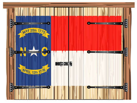 A large closed wooden barn double door with bolt and hinges and the North Carolina state flag painted on