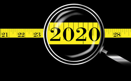 A magnifying glass on a tape measure with new year date 2020