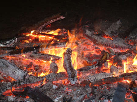 A bonfire of burning and chared logs and sticks