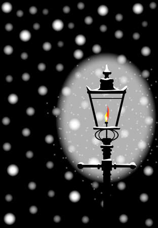 A typical old London gaslight with flame and glow celebrating new year and Christmas Banque d'images