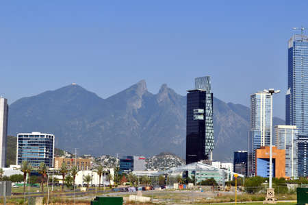 Blue Building of Monterrey Mexico City with Cerro de la silla de fondo de day Editorial