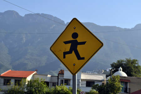 Yellow mexican sign misses a child crossing the street Stock Photo