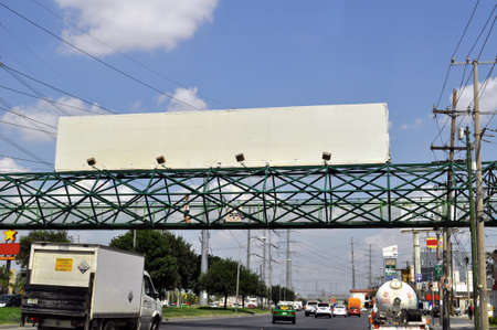 White panoramic advertisement on pedestrian bridge in the city of monterrey Nuevo Leon Mexico Editorial