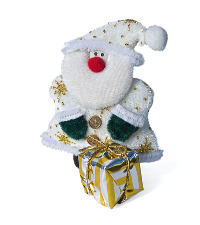cordiality: Toy Santa Claus made from knitted fabric with a gift.Isolated on white background.