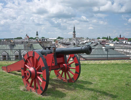 Red cannon stands on ravelin сity of Zamosc, Poland