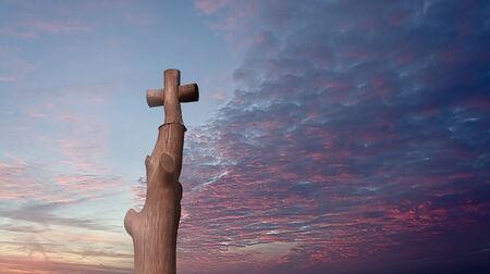 portent: Wooden cross of scarlet sunset