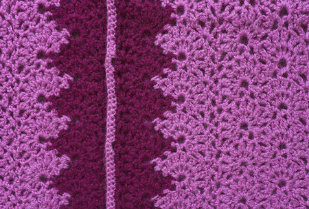 inset: Openwork knitted fabric made of pink yarn with dark inset  Crochet knitting  Stock Photo