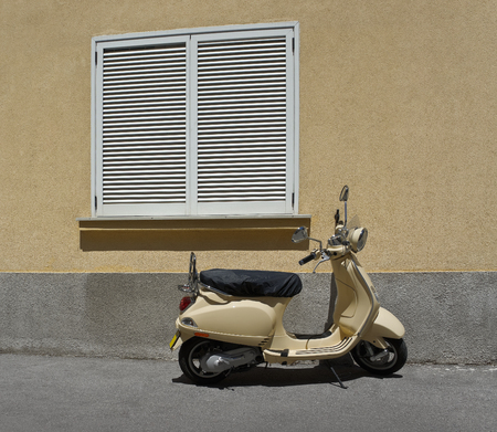 Motorbike on the background wall and window from closed shuttered photo