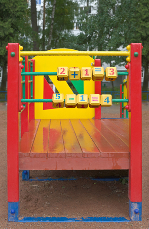 additional training: Cubes with numbers are on playground.Focus is on the foreground.