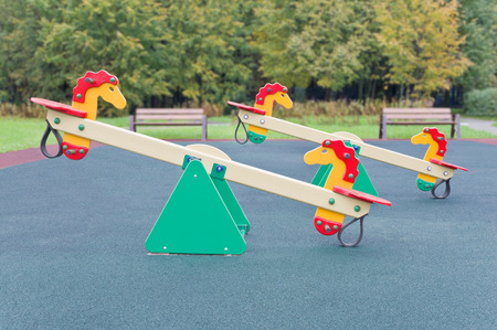 Seesaw in the shape of the horses for the playground. Small depth of field photo