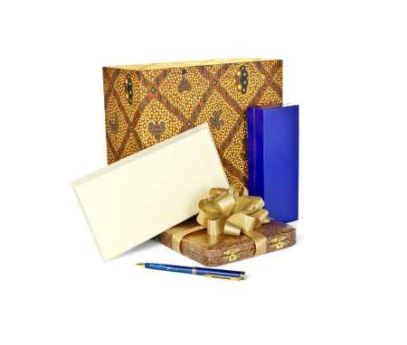 Cases for gifts, envelope and pen isolated on white background photo