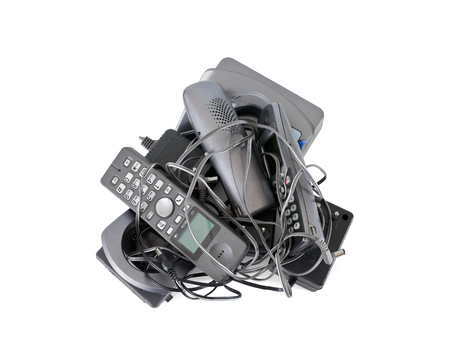 telephones: Heap of cordless telephones and cables isolated on white background