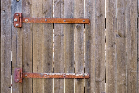 wicket gate: Fragment of closed wooden gate with rusty hinges