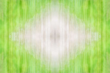 basis: Abstract symmetrical ornamental pattern of beige and green with copy-space. Seamless texture