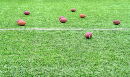rugger: Rugby balls scattered on playing field with white line markings