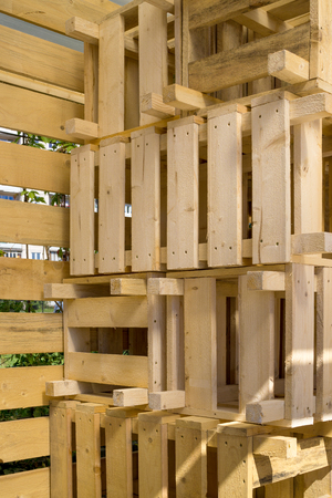 storage bin: Empty wooden new crates stacked in pile. Natural texture