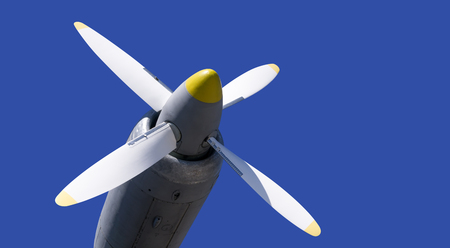 aluminum airplane: Propeller of military aircraft on background blue sky