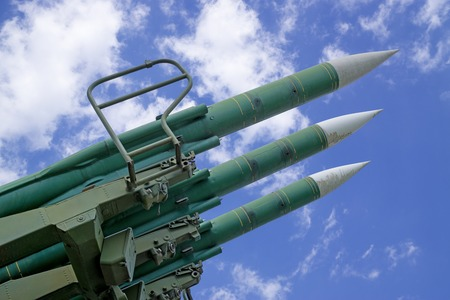 missiles: Three military missiles on background cloudy blue sky