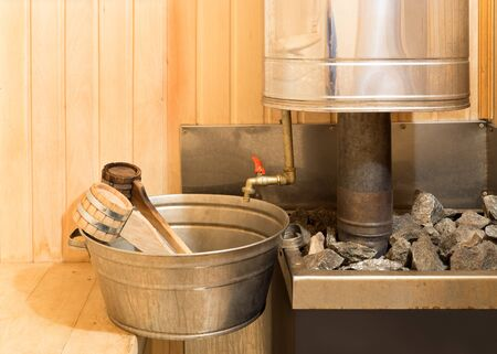 vaporarium: Stove with stones, basin and ladles in steam room