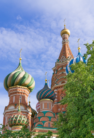 ecclesiastical: Domes of St. Basils Cathedral against background of blue sky