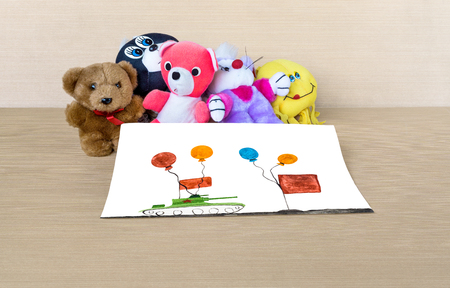 stuffed toys: Stuffed toys and picture military parade are on table