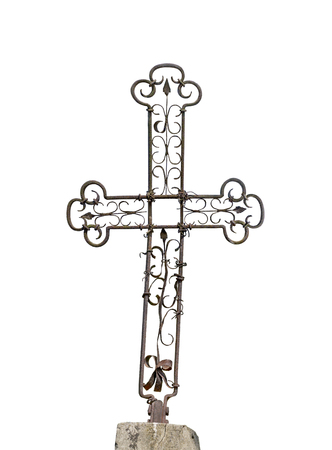 Old metal rusty Christian cross isolated on white background