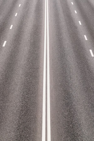 carriageway: Empty asphalted highway with road markings, outgoing to perspective Stock Photo