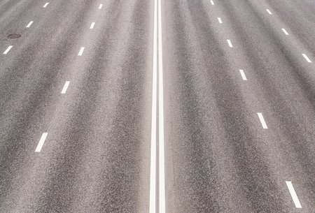 outgoing: Empty asphalted highway with road markings, outgoing to perspective Stock Photo
