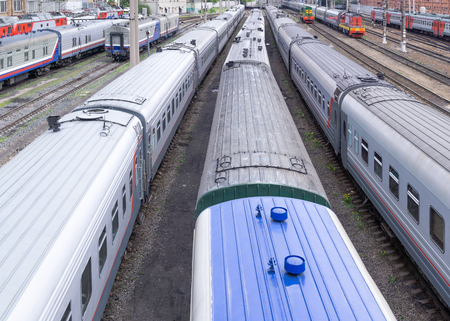Roofs of passenger trains at railway station. View from above