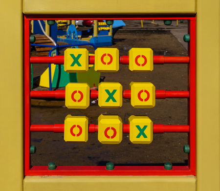 Cubes for game tic-tac-toe are in frame on background of playground Stock Photo