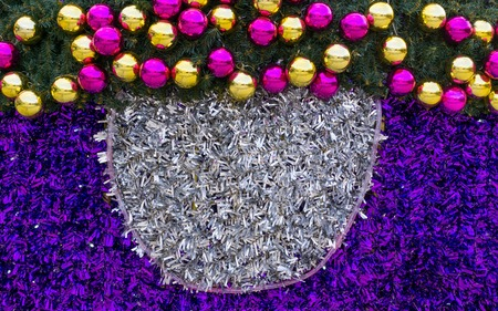 Christmas balls and ornaments made from tinsel. Full frame. Festive background