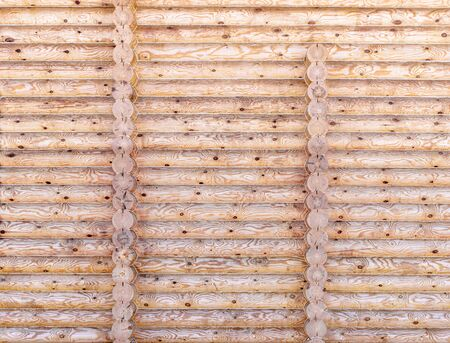 New log wall covered protective composition for wood. Texture timber