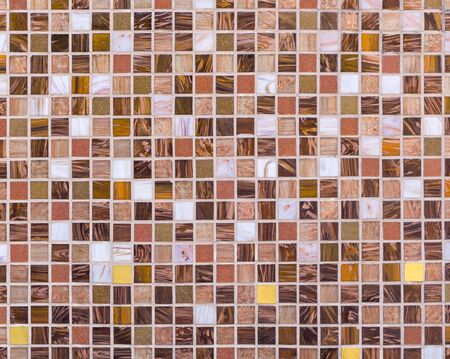 Mosaic panel made of multicolored tiles of square shape. Background, texture
