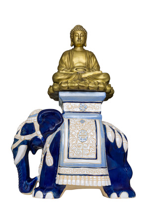 Golden Buddha sits in lotus posture on blue ceramic elephant.  Isolated on white background Sajtókép