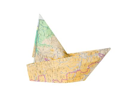 Paper ship made of geographical map is isolated on white background