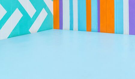 Empty corner of room with blue floor and walls with bright geometric pattern. Wooden structure, background. Copy space Reklamní fotografie