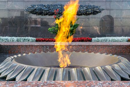 Burning eternal flame at mass tomb of soldiers. Memorial in honor of victory in second world war