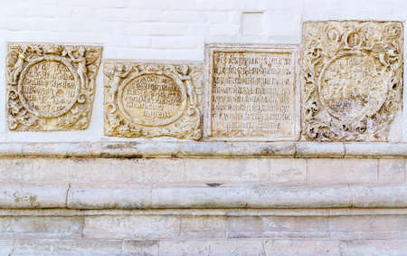 ISTRA, RUSSIA - SEPTEMBER 12, 2017: Orthodox New Jerusalem Monastery. Commemorative stone plaques with ancient texts in wall of Resurrection (Voskresenskiy) Cathedral.