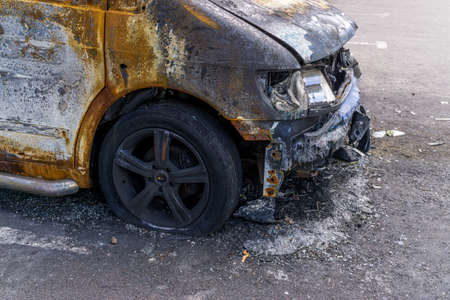 Fragment of burnt car after conflagration. Emergency. Insurance event