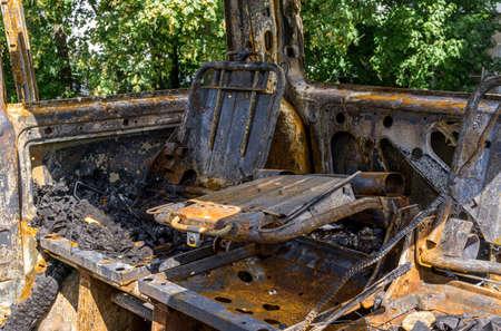 Fragment of interior burnt car after conflagration. Emergency. Insurance event