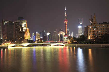 Shanghai skyline at light photo