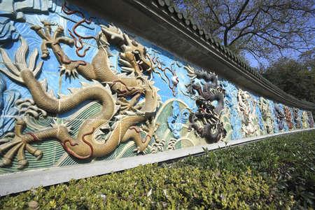 forbidden city: Chinese ancient royal of ceramics orange and black dragon Stock Photo