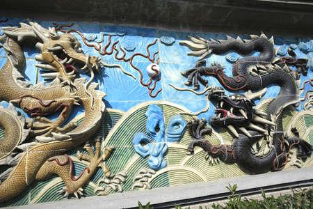 Chinese ancient royal of ceramics orange and black dragon 免版税图像