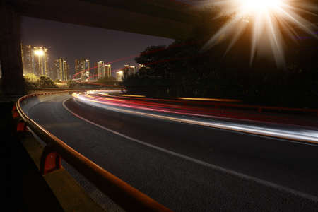 Long exposure photographs of urban night dusk highway traffic  Stock Photo
