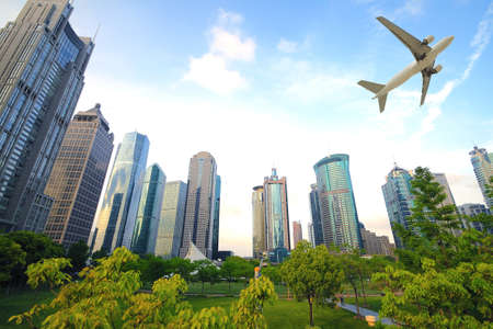 Shanghai,Aircraft is flying in the modern urban buildings Stock Photo