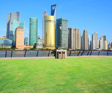 Landscape grass prospects the Shanghai Lujiazui city buildings of landmark sunny skyline  photo