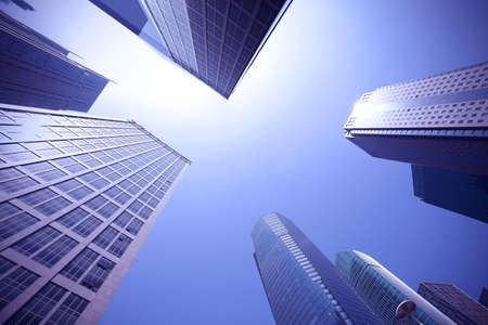 Looking up at the modern urban office buildings backgrounds at Shanghai   Stock Photo