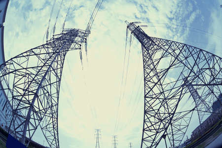 Bottom look up power transmission towers of sun sky  photo