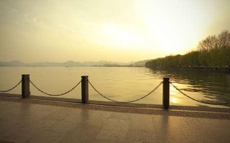 Sunset of West Lake in Hangzhou  photo