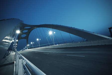 Modern steel structure bridge night scene